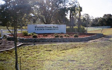 The entrance to Prairie Creek Park, which offers seclusion and natural beauty in a deed-restricted community.